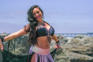 Girl belly dancing on the beach